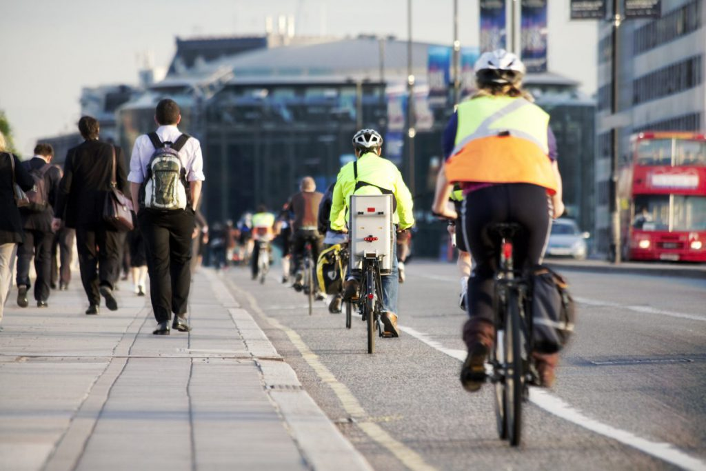 cyclists in the bike lane on their way to work